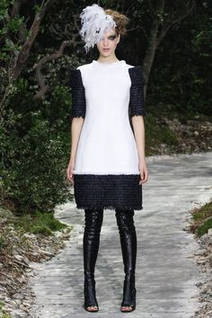 The band on the frame shoulders continues around and ties loosely over the back of the dress, which is otherwise deepish -- yet demure. #chanel #spring2013 #couture