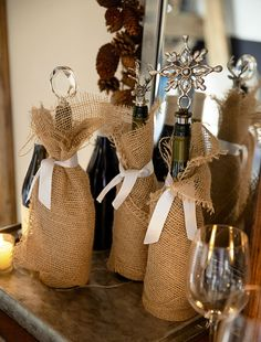 Wrap wine bottles in burlap and tie with simple grosgrain ribbon.  http://rstyle.me/n/c5kgznyg6