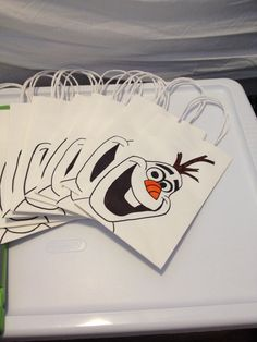 Olaf - party favor bag for Frozen Theme bday Party. Drew Olaf's face on each bag (actually traced Olaf's face) .