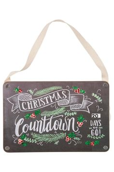 """Christmastime can seem so magical as a child, and it's always fun as an adult to try and remember and even feel some of that magic again! The practice of counting down the days builds the excitement of the big day approaching, and this hanging sign features a countdown window so you can easily keep track. The chalk art look is very cute and vintage inspired.    Measures about 6"""" by 9"""", not including the ribbon hanger.   Christmas Countdown Art by Primitives by Kathy. Home & Gifts - Home…"""