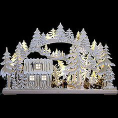 Stunning candle arch from the Ore Mountains. A candle arch is part of every traditional Christmas decoration in Germany. A great piece of crafstmanship!