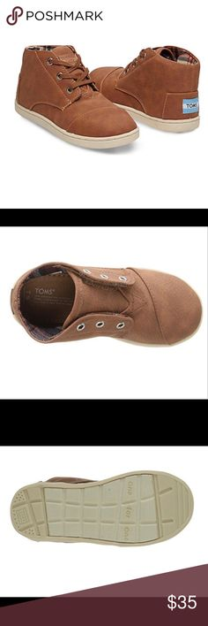 """✨HP✨ TOMS Paseo Mid-Top Boys Shoes You will love these handsome little shoes but as an added bonus your little guy will think they are """"cool"""" too! 😀  These are in TOMS classic Mid-top style with (faux) tan leather with matching shoe strings.  These shoes can also be worn without lacing.  The shoes also have their classic toe top-stitch detailing which is a nice touch.  They have a lightly padded insole and light arch support.  The sole is a flexible, one-piece, mixed rubber sole.  NWT but…"""