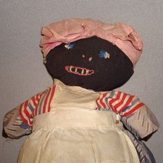 "Black and White Topsy Turkey Cloth Doll, c. 1900  If you love early cloth dolls, you'll know what I mean when I say the exquisite faces on this early 19thc. Topsy Turvy made my heart skip a beat when I first saw the doll in the exhibit ""No Longer Hidden, "" black dolls from the collection of Pat Hatch.    The doll is a bit of a mystery because the white doll's faces and hair look as if they were printed, while the black dolls face appears to be hand painted. The bodies themselves are treadle s..."