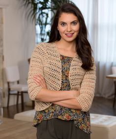 Crochet a bolero that matches everything! With a lacy pattern and three-quarter-length sleeves, this sweater goes from daytime to evening with ease.