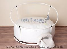 The Newborn Poser measures approximately 40 inches in diameter and is 12 inches tall. The bean bag consists of a white vinyl fabric with a Velcro.