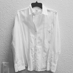 Banana Republic button up dress shirt Another fab banana republic dress shirt. This is labeled as a medium but is sized more like a small. All buttons are pearly and add some pizazz to this classic shirt. Some light discoloration in under arms. No other signs of wear. Banana Republic Tops Button Down Shirts