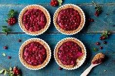 These delicious vegan gluten-free lingonberry cheesecake tarts hide a little colorful secret inside - the creamy cheese has beetroot!