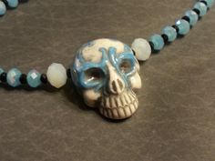 """""""Sugar - Sugar"""" Hand painted Peruvian ceramic sugar skull, opaque cream and light turquoise glass crystals - Custom order - previously sold.  Find me at: www.crafteelaydee.com"""