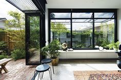 Architect Tim Angus designed horizontal aluminium sun shades with fixed angled blades for the north and west windows in this Melbourne renovation. They provide shading and passive design benefit without sacrificing views of the sky. photo: Ben Hosking