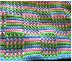 """Glad everyone likes it! I have been doing this pattern for years so its by memory now. Start with 3 colors. Each """"block"""" is 9 stitches so for however wide you want the blanket, count in 9 to get your foundation (and always make it an uneven number of """"blocks) eg: 19 blocks(makes it about 5' long) 19x9=171 stitches then add 4 =175 sc for the foundation row. Row 1-2:Sc, switch to next color Row 3: sc 2 stitches,* front post double crochet(look it up), sc, until you have 5 posts, sc 9, then…"""