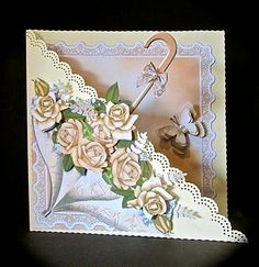 """The card front is in the shape of an open umbrella filled with flowers. There are 3 sheets in the kit - card front, decoupage, insert, greeting labels and a backing sheet. Card is 7"""" square when finished. Instructions included."""