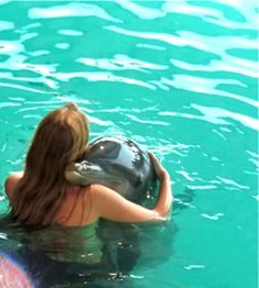 My dream job has always been to be a Dolphin Trainer...I would at least like to swim with them at some point!