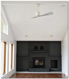 LOVE this black brick fireplace wall! Interesting idea to paint everything on far wall a rich dark color Black Brick Fireplace, Black Brick Wall, Paint Fireplace, Fireplace Ideas, Classic Fireplace, Gas Fireplace, White Ceiling Fan, Ceiling Fans, Traditional Fireplace