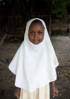 Veiled muslim girl in Mikindani, Tanzania    Mikindani, Tanzania.