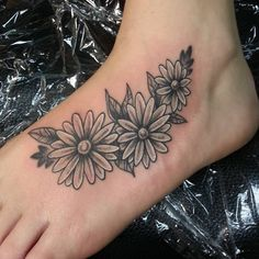 Photo by (mynameisjoe81) on Instagram |  #tat, #tats, #tatsofinstagram, #tattoo, #tattoos, #tattoosofinstagram, #tattoolife, #tattooartist, #blackandgray, #whitehighlights, #daisy, #daisies, #foot, #foottattoo, #foottattoos