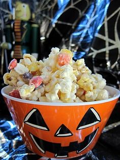monster munch- almond bark, popcorn, candy corn, peanuts, reeces pieces