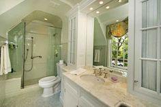 herringbone tile in shower. marble floors. subway tile on walls. Perfect glass door arrangement for our cape cod bath problem!