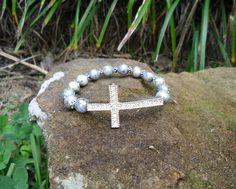 Silver Rhinestone Cross & Blue Stretch Bracelet $7.00 BR165