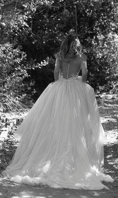 Elegant sheer long-sleeve ballgown wedding dress; Featured Dress: Erin Cole