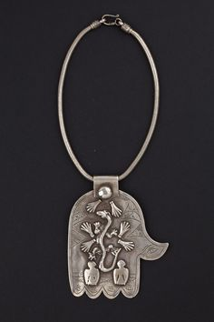 Morocco | Silver Khamsa pendant from the beginning of the 1900s. I find these pieces of jewelry very intriguing; many of their motifs, archetypes, if you like, are present in Sardinian jewelry