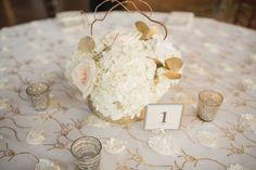 """We love these photos by Julie Afflerbaugh Photography of Shannon & Brian's wedding in Vail this July featuring our beautiful """"Peony"""" overlay linen in Ivory-Gold. Definitely adds a soft floral touch to their natural-inspired event design accented by blues and soft pinks next to our classic Duchess Satin in White. https://www.facebook.com/MileHighCelebrations/posts/942684902473371 — at Donovan Pavilion."""
