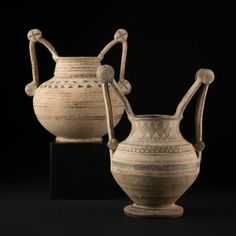 ELEGANT PAIR OF TROZELLA VASES - Apulia 4th cent. BC.  A typical Messapian vase, the 'trozella' could be found along the Salento peninsula and was an obligatory tomb offering during the 5th cent. BC. Read more about the interesting history of this piece here: http://www.galeriegolconda.com/en/products/trozella-apulian-daunio-messapian-terracotta-ceramic-pottery-galerie-golconda/