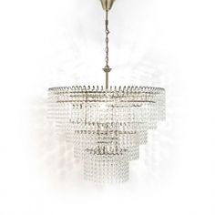 Found in the bedrooms at Soho House Chicago and inspired by turn of the century design, Lexington is our largest and most glamorous light. A tiered waterfall chandelier, it features layers of hand-polished glass droplets on a brass-plated steel cage. Each glass prism has faceted edges that throw the light in different directions, creating a beautiful light pattern around the room. The totem designed bulb configuration means light is distributed equally throughout the chandelier. It would…