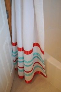 love the idea of using ribbon to dress up a plain shower curtain!
