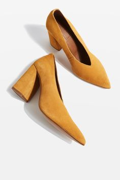 Choose a feminine touch for your footwear in these mustard leather shoes with a flared block heels. In a classic mustard, we see them looking cool with frayed hem jeans or a pleated midi skirt.