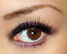 Smokey eyes, black and plum. So pretty for brown eyed girls.