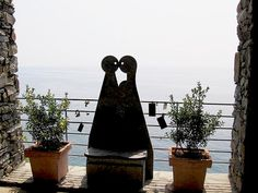 The Via dell'Amore hiking trail in Cinque Terre, Italy runs between Riomaggiore and Manarola.  It is known as the Lover's Lane walk in Italy. There is a lookout where couples come to place a lock with their names on the railing and throw the key into the sea.  Symbolizing their love will last forever. http://www.discoverwalking.com/blog/via-dell-amore-cinque-terre.php