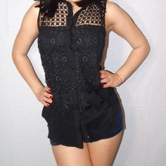 Black button down top Black button down top. Sleeveless with floral design in black. Tops Button Down Shirts