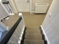 Monachrome pinstriped carpet, hand turned to create a stair runner.