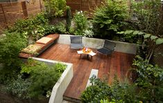 Courtyard  Sleek Urban Setting - nice mix of plants and decking, would also like seats built into walls.