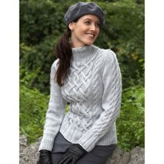 Sterling Cables Sweater: Intricate aran-style cable sweater with delicate braided accents. Free pattern