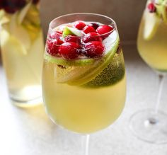 White Cranberry Holiday Sangria - a perfect cocktail to serve during the holidays! #cocktails