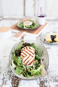 wild herb salad with grilled ricotta and blueberry dressing.