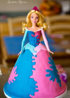 a full tutorial for a Disney's Sleeping Beauty princess cake, complete with instructions for a pink, blue OR multicolored splattered dress Princess Aurora Party, Disney Princess Dresses, Princess Cakes, Sleeping Beauty Cake, Sleeping Beauty Princess, Disney Princess Decorations, Aurora Cake, Barbie Cake, Barbie Doll