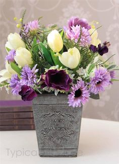 Purple and white flowers in zinc vase