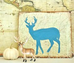deer silhouette on maps.