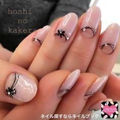 Une french inversé avec pour blanc un magnifique nail art fleural