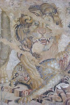 """Mosaic of a Lion and a Leopard from the """"House of the Doves"""" in Pompeii, I century bc/I century CE, now in the Archaeological Museum of Naples"""