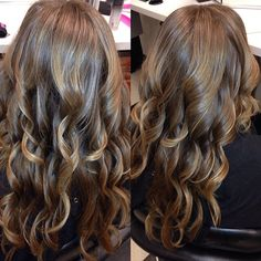 subtle blonde highlights on her nice natural light brown hair.