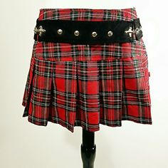 """Tripp NYC Red Plaid Mini! Pleated red plaid school girl mini with an edge! It has silver metal studs and buckles.  Back zip closure waist 28"""" length 12"""" can be worn all year round, pair with some black combat or moto boots and tights for winter, wedges or platforms for summer! Tripp nyc Skirts Mini"""