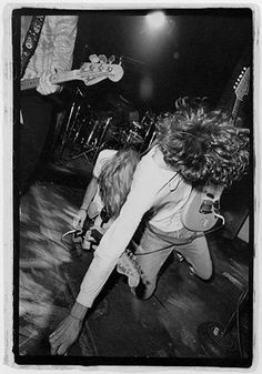Mudhoney members Mark Arm (left) and Steve Turner (right) falling into each other during a performance.