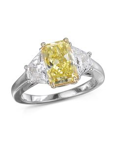 An platinum ring with a radiant cut diamond. The ring also has two trapezoid cut diamonds on the sides of the center diamond.The center diamond is CTW while the two trapezoid diamonds are CTW. Radiant Cut Diamond, Diamond Cuts, Yellow Diamond Rings, Gia Certified Diamonds, Platinum Ring, Diamond Engagement Rings, Diamond Jewelry, Wedding Bands, Jewels