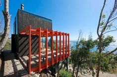 Spectacular cliffside cabin off the Chilean coast