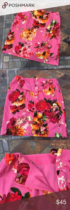 "🆕 Talbots | Bright Spring Day Skirt Pink skirt has beautiful bright floral design with matching pink lining & 7.75"" back slit. Back slit is still stitched in place. Measurements flat are 18"" waist, 23.25"" long & 7.75"" zipper in back. Inside button at top of zipper. In excellent preloved condition with NO damage. Talbots Skirts Midi"