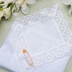 This sweet embroidered hankie makes a thoughtful gift for the Mother of the Bride and will surely come in handy if she cries at the wedding ceremony!
