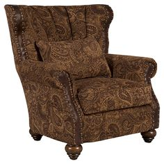 Paisley chenille and top grain leather lounge chair with hand-applied nailhead trim.